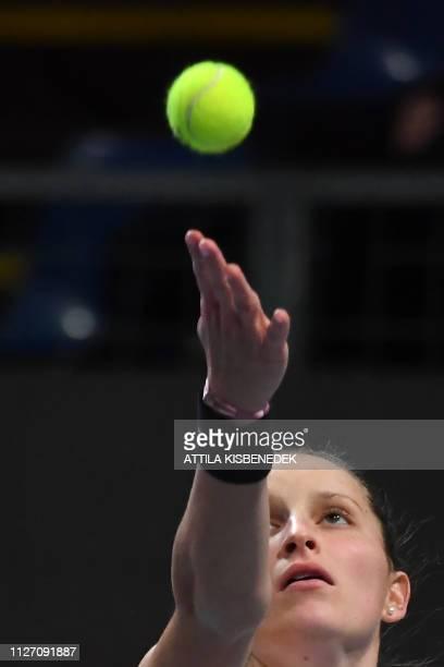 Czech Republic's Marketa Vondrousova serves to Belgium's Alison Van Uytvanck during their final match at the WTA Hungarian Open Ladies' tennis...