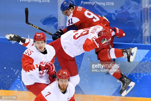 TOPSHOT Czech Republic's Martin Erat collides with Russia's Ilya Kablukov in the men's semifinal ice hockey match between the Czech Republic and the...