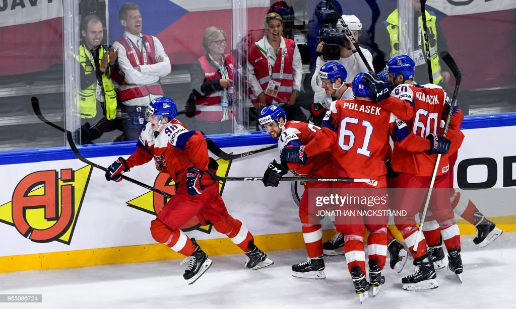 Czech Republic's Martin Necas (L) celebrates with his teamates after scoring the equaliser goal seconds before the end of the 2018 IIHF Men's Ice Hockey World Championship match between Czech Republic and Slovakia on May 5, 2018 in Copenhagen.