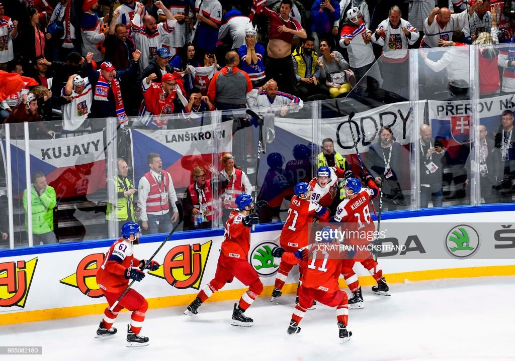 Czech Republic's Martin Necas (2nd R) is congratulated by teamates after scoring the equaliser goal seconds before the end of the 2018 IIHF Men's Ice Hockey World Championship match between Czech Republic and Slovakia on May 5, 2018 in Copenhagen.