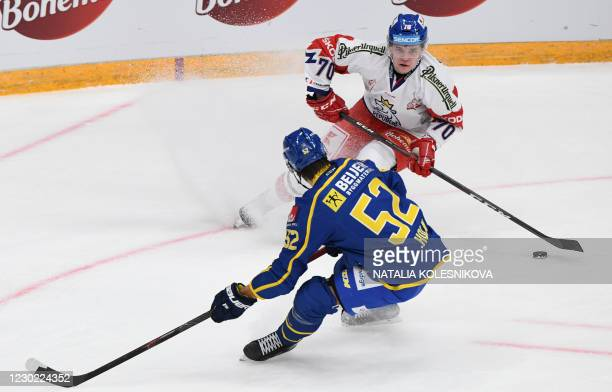 Czech Republic's Matej Blumel vies with Sweden's Philip Holm before scoring a goal during the Channel One Cup of the Euro Hockey Tour ice hockey...
