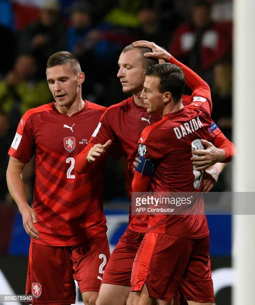 Czech Republic's Michael Krmencik celebrates with his team mates Pavel Kaderabek and Vladimir Darida after scoring during the FIFA World Cup 2018...