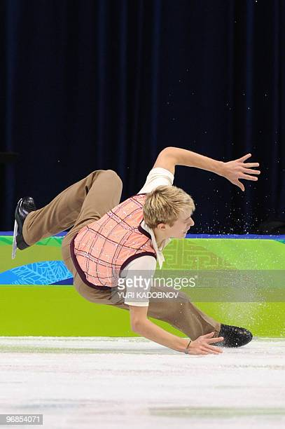 Czech Republic's Michal Brezina falls down as he performs in the Men's Figure skating free program at the Pacific Coliseum in Vancouver during the...