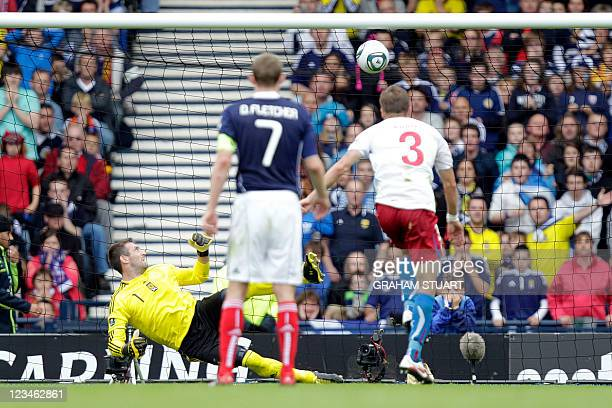 Czech Republic's Michal Kadlec scores their second goal against Scotland during an UEFA Euro 2012 qualifier football match at Hampden Park, Glasgow,...
