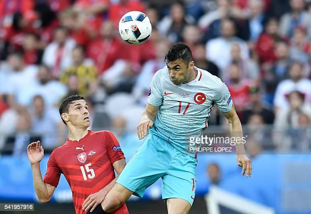 TOPSHOT Czech Republic's midfielder David Pavelka vies with Turkey's forward Burak Yilmaz during the Euro 2016 group D football match between Czech...