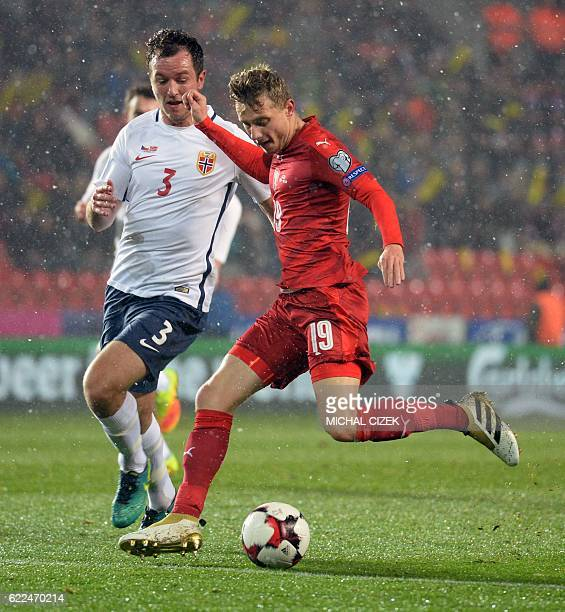 Czech Republic's midfielder Ladislav Krejci vies for the ball with Norway's defender Even Hovland during the World Cup 2018 qualification football...