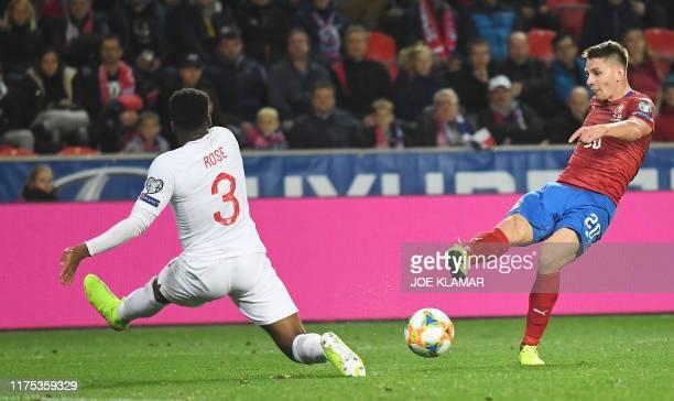 Czech Republic's midfielder Lukas Masopust shoots past England's defender Danny Rose during the UEFA Euro 2020 qualifier Group A football match Czech...