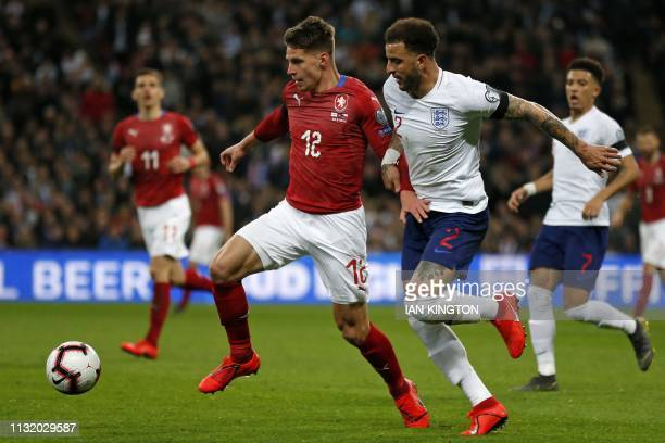 Czech Republic's midfielder Lukas Masopust vies with England's defender Kyle Walker during the UEFA Euro 2020 Group A qualification football match...