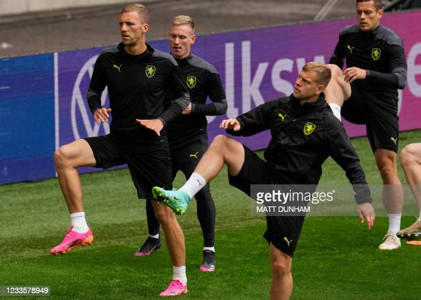 Czech Republic's midfielder Tomas Soucek and Czech Republic's defender Vladimir Coufal take part in their MD-1 training session at Wembley Stadium in...