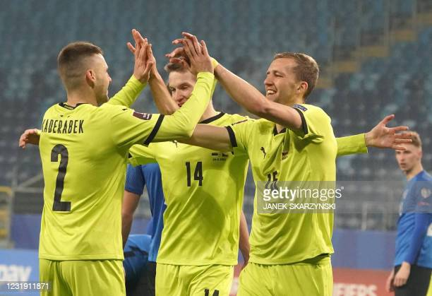 Czech Republic's midfielder Tomas Soucek celebrates scoring with his teammates during the FIFA World Cup Qatar 2022 qualification football match...