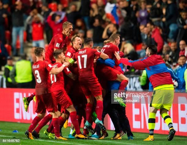 Czech Republic´s midfielder Vladimir Darida celebrates with teammates scoring during the FIFA World Cup 2018 qualification football match between...