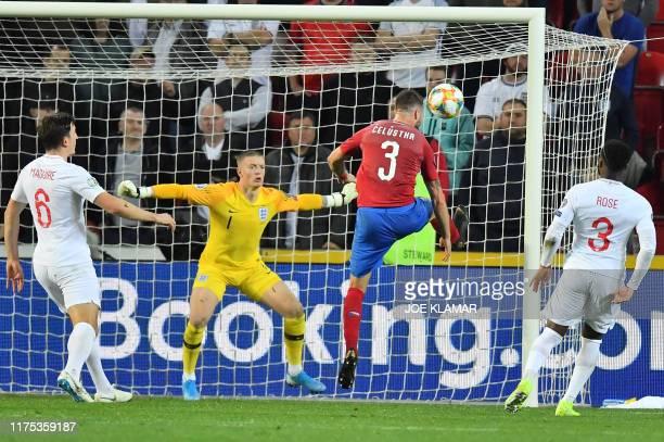 Czech Republic's Ondrej Celustka fails to score past England's goalkeeper Jordan Pickford during the UEFA Euro 2020 qualifier Group A football match...