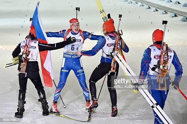 Czech Republic's Ondrej Moravec with teammates Veronika Vitkova , Gabriela Soukalova and Michal Slesingr after the Mixed relay competition of the IBU...