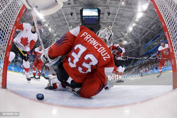 Czech Republic's Pavel Francouz lets in a goal in the men's bronze medal ice hockey match between the Czech Republic and Canada during the...