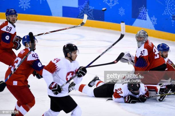 Czech Republic's Pavel Francouz watches the puck in the men's preliminary round ice hockey match between the Czech Republic and Switzerland during...