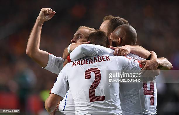 Czech Republic's Pavel Kaderabek is congratulated by teammates after scoring a goal during the Euro 2016 qualifying football match between The...