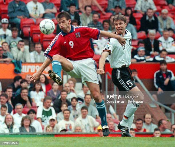 Czech Republic's Pavel Kuka shields the ball from Germany's Thomas Helmer during today's Euro 96 match at Old Trafford Photo by Dave Kendal/PA