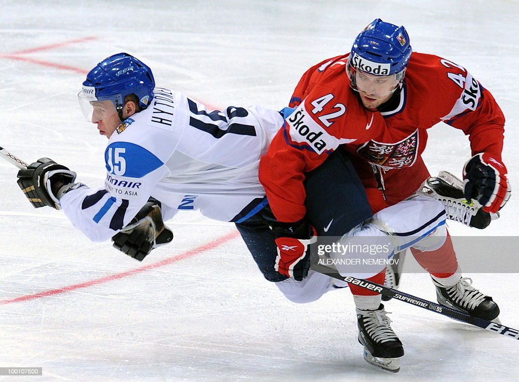 Czech Republic's Petr Koukal (R) and Finland's Juha-Pekka Hytonen vie during the IIHF Ice Hockey World Championship quarter-final match Finland vs Czech Republic in the western German city of Cologne on May 20, 2010. The 2010 IIHF Ice Hockey World Championships are taking place in Germany from May 7 to 23, 2010.