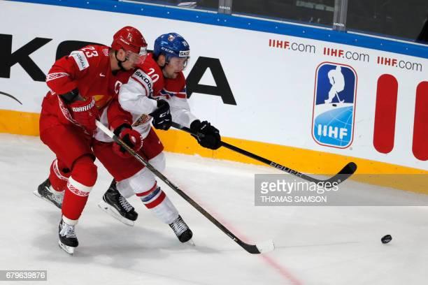 Czech Republic's Petr Vrana challenges Belarus' Andrei Stas during the IIHF Men's World Championship group B ice hockey match between Belarus and...