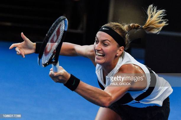 TOPSHOT Czech Republic's Petra Kvitova hits a return against Australia's Ashleigh Barty during their women's singles quarterfinal match on day nine...