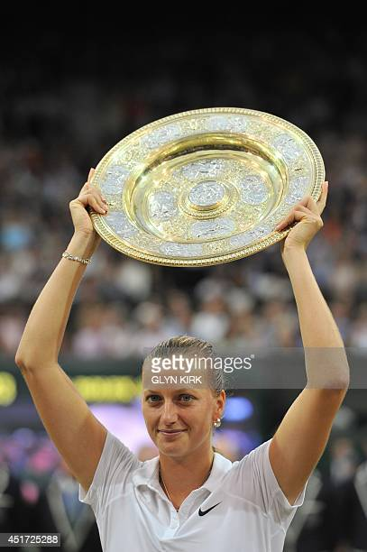 Czech Republic's Petra Kvitova holds the winner's Venus Rosewater Dish during the presentation after beating Canada's Eugenie Bouchard in the women's...