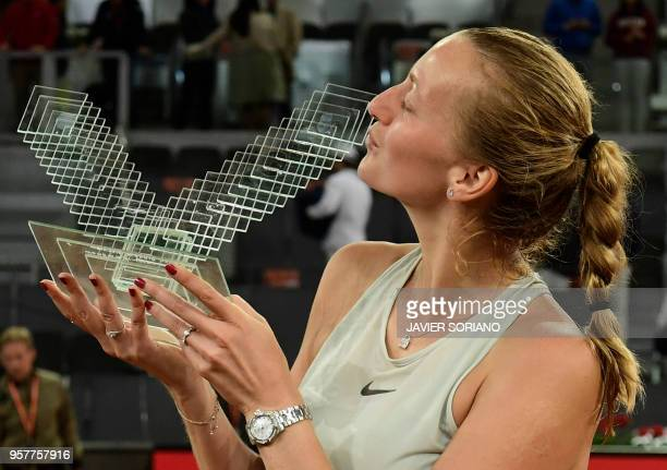 Czech Republic's Petra Kvitova kisses her first place trophy after defeating Netherlands' Kiki Bertens during their WTA Madrid Open final tennis...