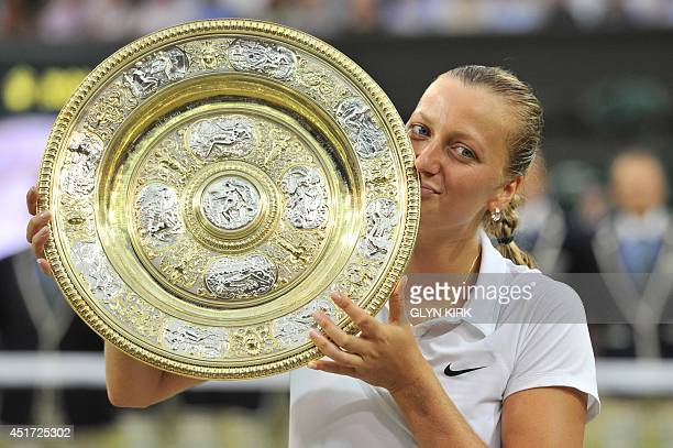 Czech Republic's Petra Kvitova kisses the winner's Venus Rosewater Dish during the presentation after beating Canada's Eugenie Bouchard in the...