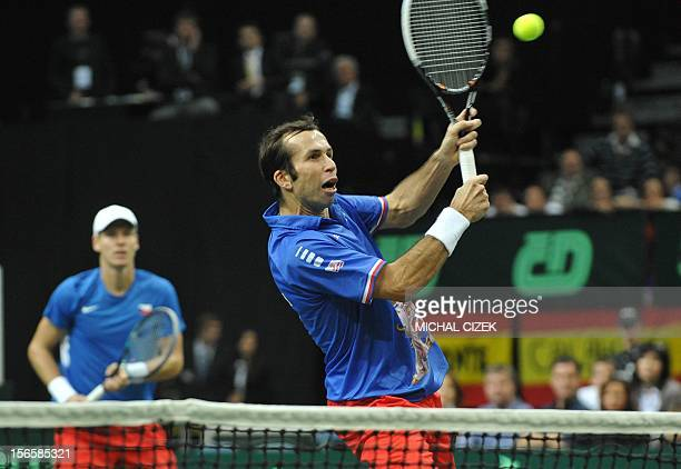 Czech Republic's player Radek Stepanek playing with Tomas Berdyc returns a ball to Spanish tennis players Marc Lopez and Marcel Granollers during the...