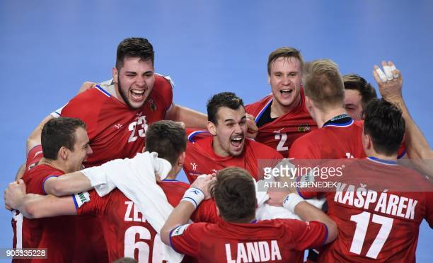 TOPSHOT Czech Republic's players celebrate after winning at the end of the group D handball match of the Men's 2018 EHF European Handball...