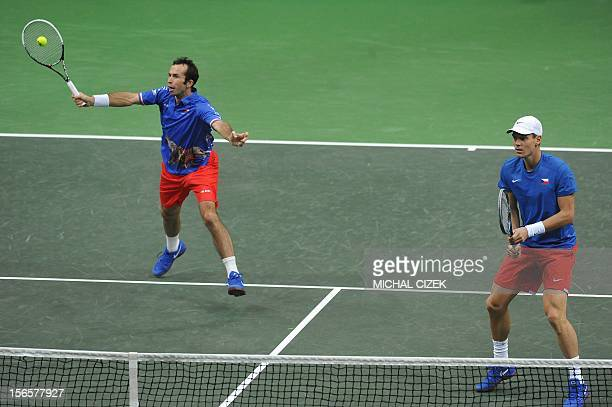 Czech Republic's players Radek Stepanek playing with Tomas Berdych returns the ball to Spanish tennis player Marcel Granollers and Marc Lopez during...