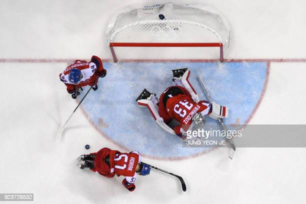Czech Republic's players react after a goal in the men's bronze medal ice hockey match between the Czech Republic and Canada during the Pyeongchang...