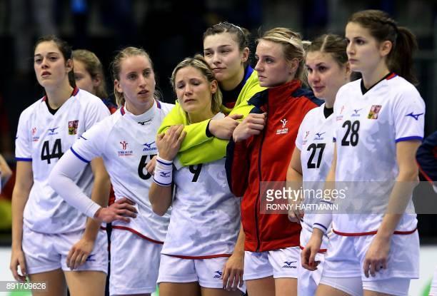 Czech Republic's players react after Netherland's team won the IHF Womens World Championship handball quater final match between Netherlands and...