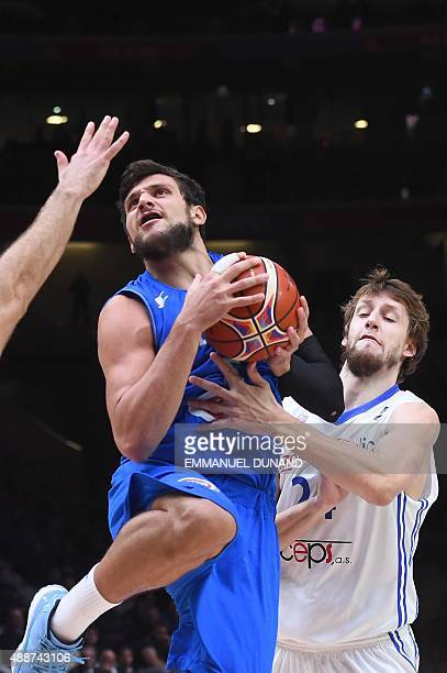 Czech Republic's power forward Jan Vesely defends against Italy's small forward Alessandro Gentile during the classification basketball match between...