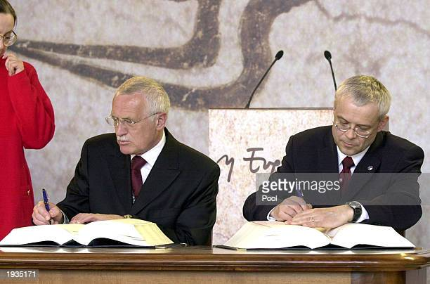 Czech Republic's President Vaclav Klaus left and Prime Minister Vladimir Spidla sign their Accession Treaty April 16 2003 at Agora's Stoa of Attalos...