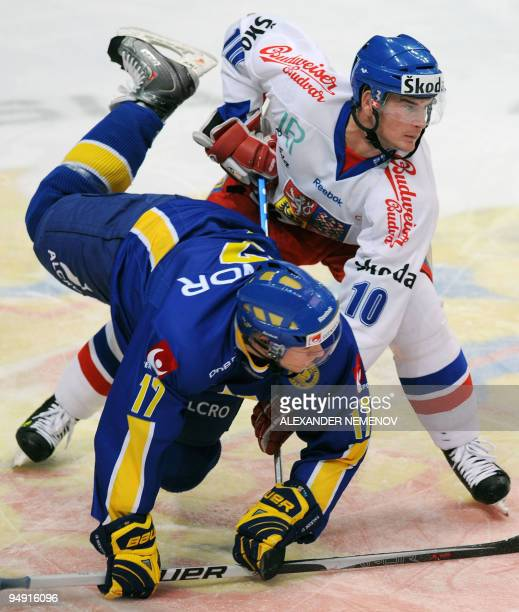Czech Republic's Roman Cervenka fights for the puck with Sweden's Andreas Falk during Channel One Cup the third event of the Euro Hockey Tour match...
