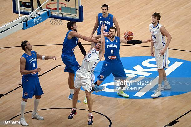 Czech Republic's small forward Pavel Pumprla is fouled by Italy's small forward Alessandro Gentile during the classification basketball match between...