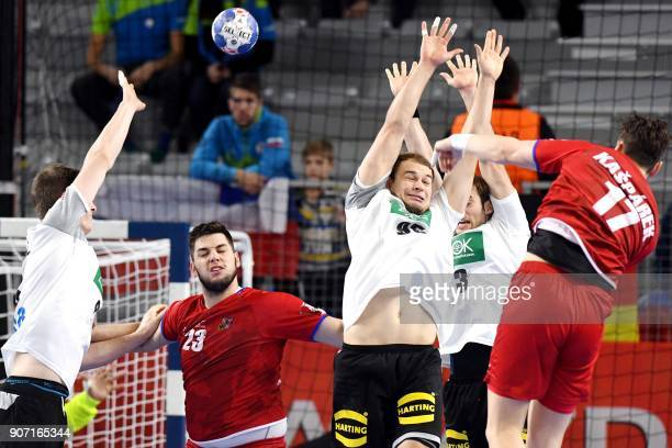 Czech Republic's Stanislav Kasparek tries to score over Germany's Paul Drux and Uwe Gensheimer during the group II match of the Men's 2018 EHF...