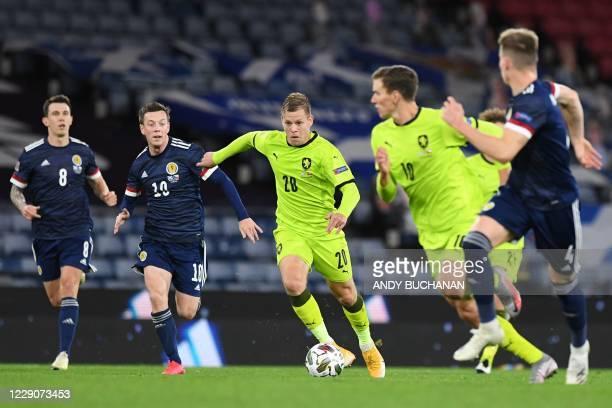 Czech Republic's striker Matej Vydra runs with the ball as Scotland's midfielder Callum McGregor challenges during the UEFA Nations League group B2...
