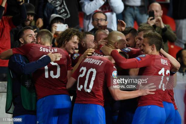 Czech Republic's team celebrate after scoring during the UEFA Euro 2020 qualifier Group A football match Czech Republic and England on October 11...