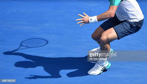 Czech Republic's Tomas Berdych casts a shadow on court as he plays a forehand return during his men's singles match against Switzerland's Roger...