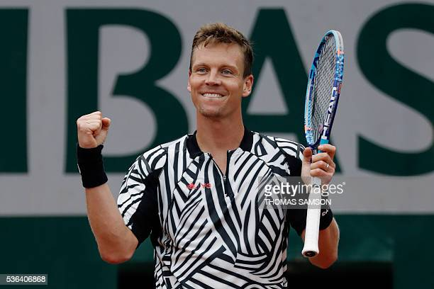Czech Republic's Tomas Berdych celebrates after winning his men's fourth round match against Spain's David Ferrer at the Roland Garros 2016 French...