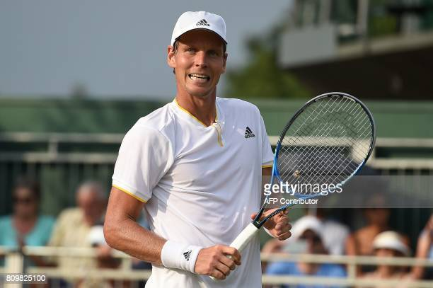 Czech Republic's Tomas Berdych reacts after winning against US player Ryan Harrison during their men's singles second round match on the fourth day...