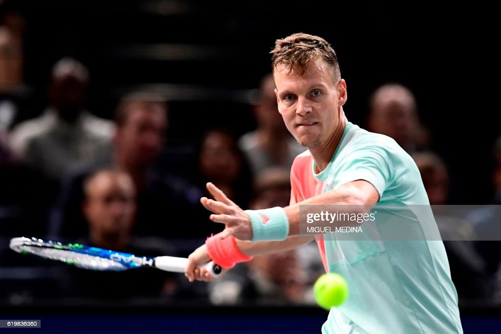 TOPSHOT - Czech Republic's Tomas Berdych returns the ball to Portugal's Joao Sousa during their second round tennis match at the ATP World Tour Masters 1000 indoor tournament in Paris on November 1, 2016. /