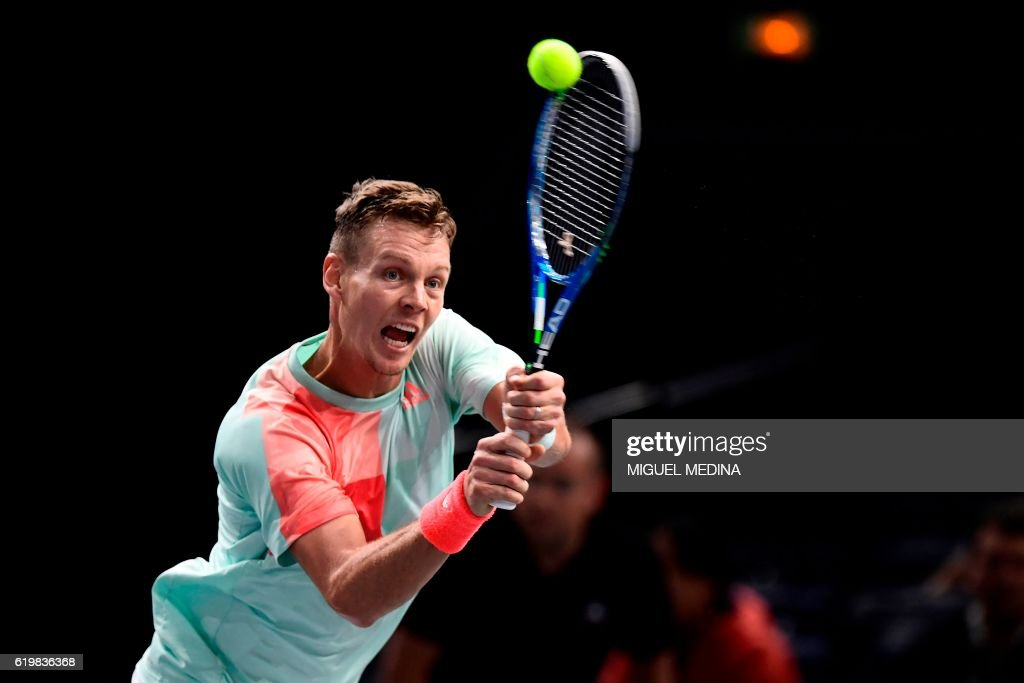 Czech Republic's Tomas Berdych returns the ball to Portugal's Joao Sousa during their second round tennis match at the ATP World Tour Masters 1000 indoor tournament in Paris on November 1, 2016. /