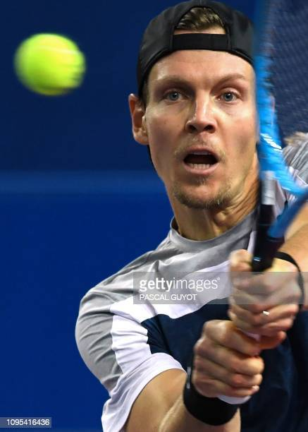 Czech Republic's Tomas Berdych returns the ball to Serbia's Filip Krajinovic during their ATP World Tour Open Sud de France tennis match in...