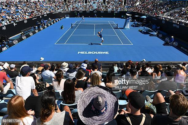 TOPSHOT Czech Republic's Tomas Berdych serves against Ryan Harrison of the US during their men's singles match on day three of the Australian Open...