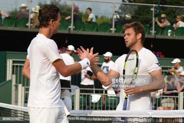 Czech Republic's Tomas Berdych shakes hands with US player Ryan Harrison after winning their men's singles second round match on the fourth day of...