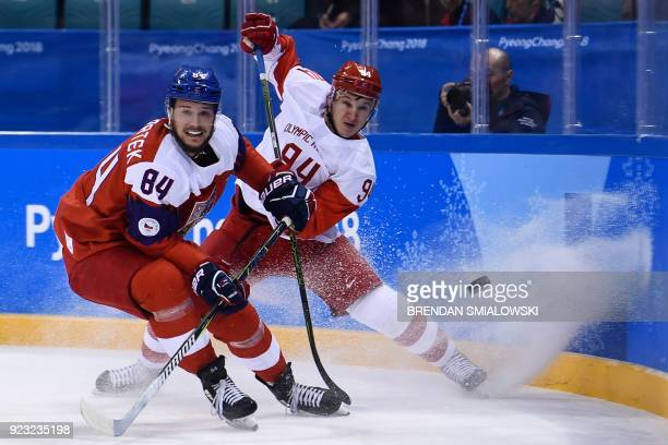 TOPSHOT Czech Republic's Tomas Kundratek and Russia's Alexander Barabanov fight for the puck in the men's semifinal ice hockey match between the...