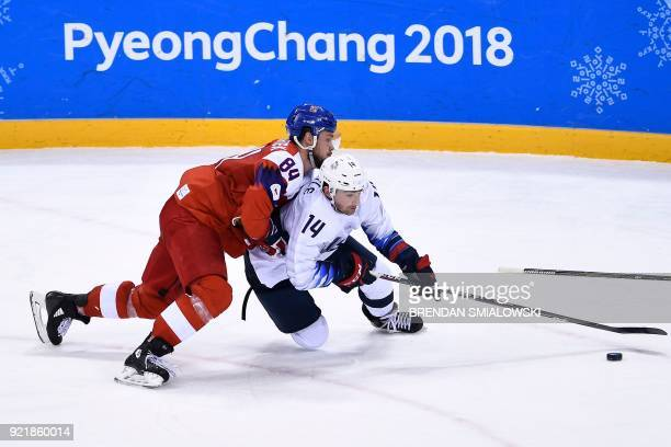 TOPSHOT Czech Republic's Tomas Kundratek and USA's Broc Little fight for the puck during overtime in the men's quarterfinals playoffs ice hockey...