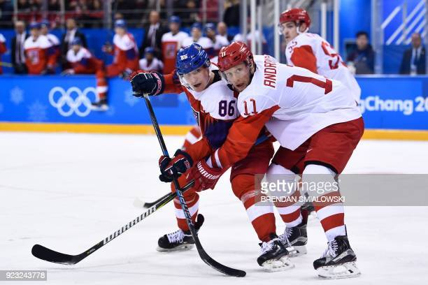 Czech Republic's Tomas Mertl and Russia's Sergei Andronov fight for the puck in the men's semifinal ice hockey match between the Czech Republic and...